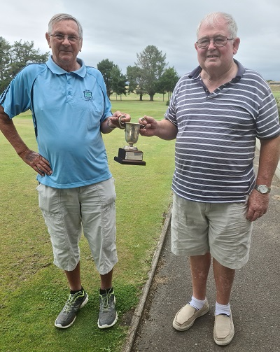 Summer Cup winner Peter Edwards presented his trophy by Club President Ivan Franklin
