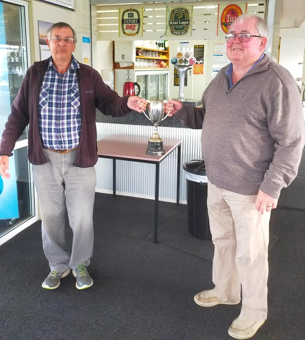 36 Hole Masters winner Peter Edwards (right) receives the trophy from Club President Ivan Franklin